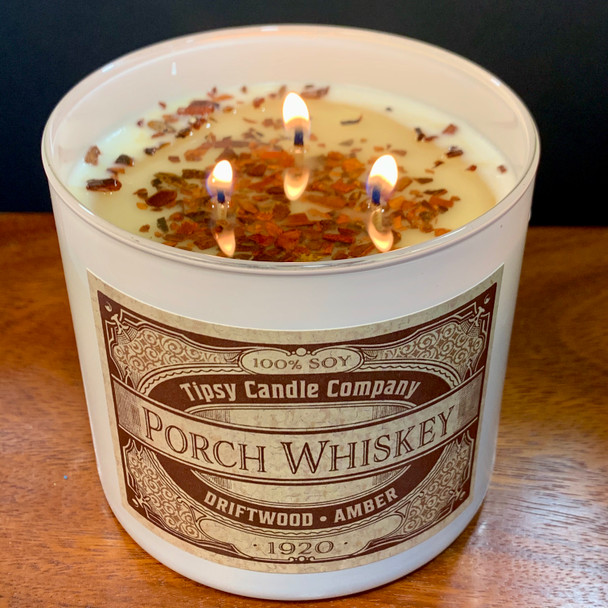 Porch Whiskey 3 wick candle burning