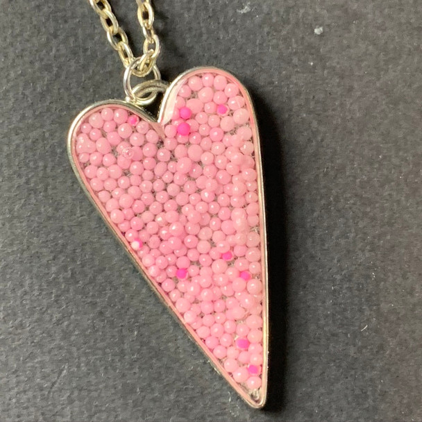 Pink sprinkles heart chain necklace, set in shiny silver. Pendant is 4in 29in matching chain.