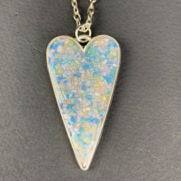 Crystal Sugar sprinkles heart chain necklace, set in shiny silver. Multi-color pastel sprinkles Pendant is 4in 29in matching chain.