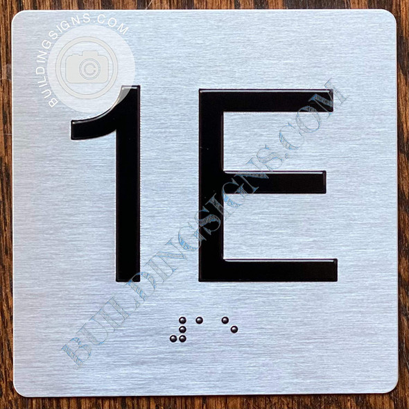 Signage Apartment Number 1E  with Braille and Raised Number