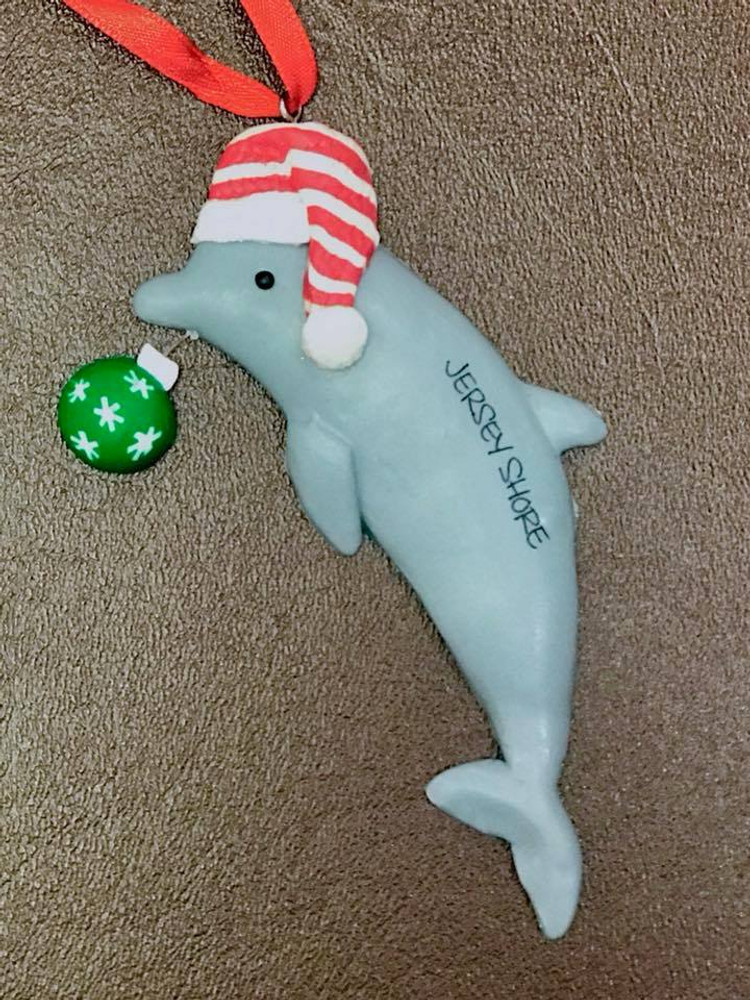 Dolphin W/ Ornament In Mouth