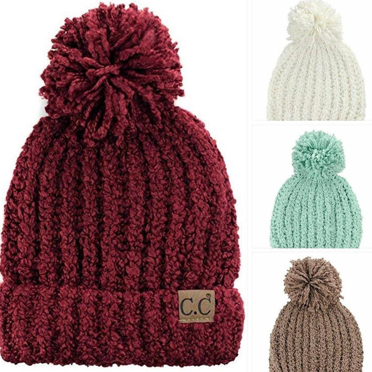 C.C Chenille Soft Stretchy Pom Cuffed Knit Beanie          Made with 100% soft acrylic   • One size fits most   • Extra roomy to cover ears   • Perfect everyday in winter time   • Outdoor activities
