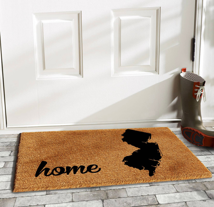 "NJ Home Doormat   17"" L x 29"" W   Made of natural coir, a dense fiber that is naturally mold and mildew resistant. Coir is a renewable resource that is durable and coarse, excellent for scraping shoes clean. Vinyl backed for increased durability and to help prevent movement, coir doormats are weather tolerant absorb  and retain their shape. For best results keep in a sheltered area such as a covered porch, keeping extreme moisture and sunlight to a minimum, vacuum, sweep or lightly hose clean."