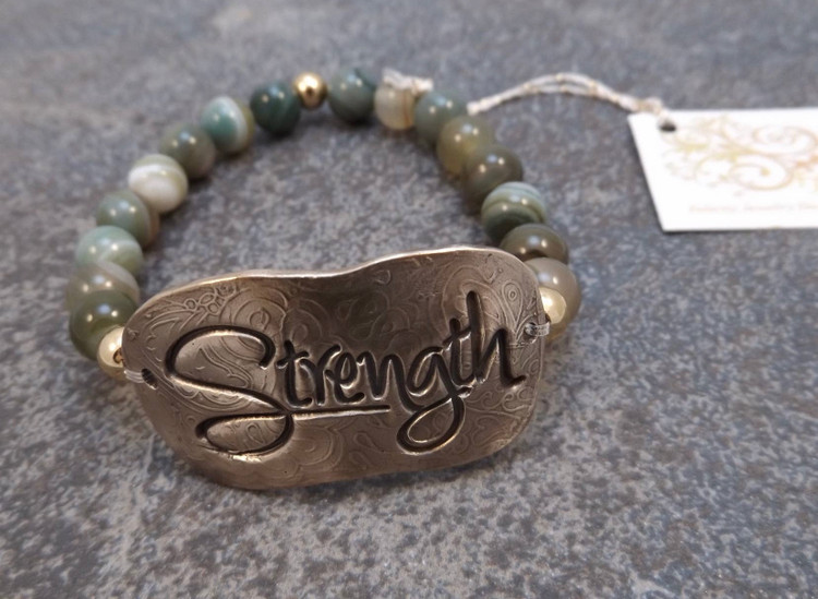 "This handmade Bronze stretch bracelet is a member of the updated ""inspiration"" bracelet series.  The focal of each piece is a hand formed solid bronze bracelet plate (1-5/8 x 3/4"")  The surrounding beads are 8mm smooth Agate. This bracelet is stretchable and should therefore fit most wrists."
