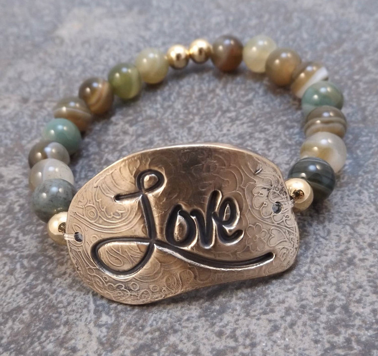 "This handmade Bronze stretch bracelet is a member of the updated ""inspiration"" bracelet series. The focal of each piece is a hand formed solid bronze bracelet plate (1-5/8 x 3/4"")  The surrounding beads are 8mm smooth Green Brown Agate.  This bracelet is stretchable and should therefore fit most wrists."
