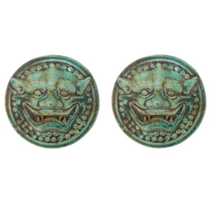 Pair of Speckled Green Lion Head Wall Sculptures