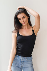 This versatile ribbed tank is very structured, and will hold you in, while allowing you to wear it alone or layer it.  A must have in every wardrobe, this seasons most versatile piece.   Model is 5'9 and wearing a size small.
