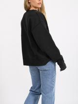 Blonde Distressed Varisty Step Sister Crew in Black Acid Wash