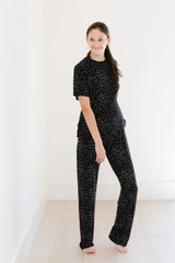 Sleep by PRIV features a brand new lightweight modal for the winter months! This gorgeous fabric will leave you wanting to stay in your PJs through the rest of the season! This all over ditzy print, tee and pant set, is both comfortable, and adorable. You would regret these PJ's, get cozy in sleep by PRIV!  100% Modal.