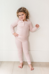 """""""Our signature luxuriously soft sleepwear fabric. The pants are fitted through the leg at ankle length with a soft, long sleeved henley shirt. We promise, they'll never want to sleep in anything else."""