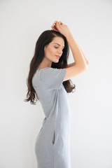 Camille features a short sleeved crew neck, running straight down the body to an ankle slip at the bottom. Pocketed to free your hands, in a slightly thicker weighted fabric.