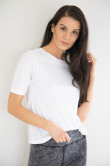 A staple basic; an ultra-soft cotton tee in a light white tint. This tee easily pairs with anything and everything from denim to shorts, wears boxy and loosely against the skin.