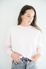 An evolution of the ottoman sweater, Caeley fits oversized with an exterior spliced surge line details and ribbed, soft fabric. Light weight, with slightly ballooned sleeves and thick ribbing along the wrist and waist. Elevate your favourite denim with a french tuck, or wear with shorts for an oversized, ultra lounge-able finish.