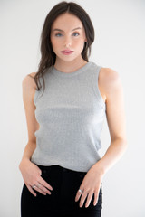 A casual basic waffle knit tank, featuring a crew neckline, ribbed arm and neck openings, and made from a light weight cotton fabric.