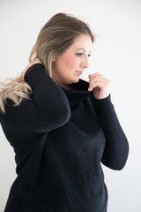 It's back! One of our best-selling sweaters, in three classic tones; Black, White and Tan. Made from a mid weight ribbed fabric, this sweater fits oversized and boxy through the body. A mock neck and drop shoulder design elevates this cozy knit, easy to pair and accessorize.