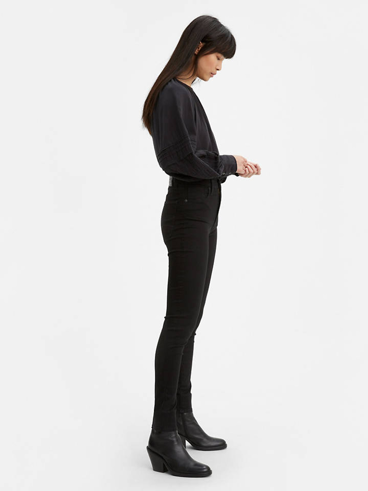 "An ultra-high rise. A super-sleek leg. The perfect amount of stretch. Levi's® Mile High Super Skinny Jeans accentuate your shape in all the right places. This figure-flattering fit does it all. Ultra high rise with a super sleek silhouette Crafted with the perfect amount of stretch for all day comfort Super skinny fit to accentuate your shape and whatever shoe you choose to wear Branded with iconic Levi's® leather patch at back waist Style # 227910052 Color: Black Celestial How it Fits Extra high rise Slim through hip and thigh Super skinny leg Measurements from size 27: Rise: 10.875"" Inseam: 30"" Leg opening: 9.25"" Composition & Care 85% Cotton, 9% Elastomultiester, 6% Elastane Denim Extreme stretch Zip fly Imported"