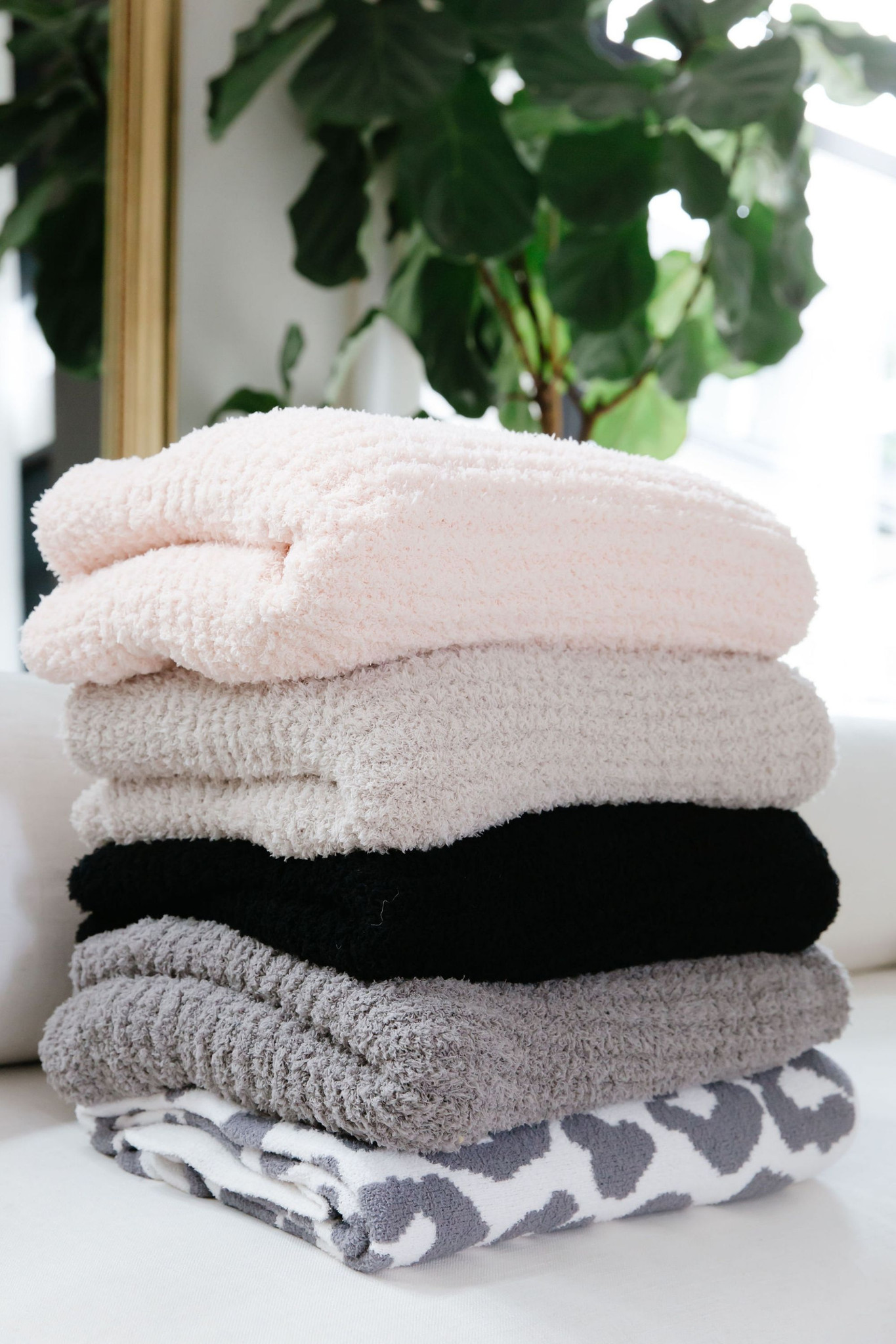 Cozy up in the most dreamy blanket you have ever seen!  LUXE By PRIV bring our brand new assortment of plush heavyweight and oversized throw blankets.  In a wide assortment of colours, these are the perfect gift for somebody you care for...even if it's yourself!  Available in Cream, Light Grey, Charcoal Grey, Blush/Pink, Black, and Grey Leopard  100% Polyester