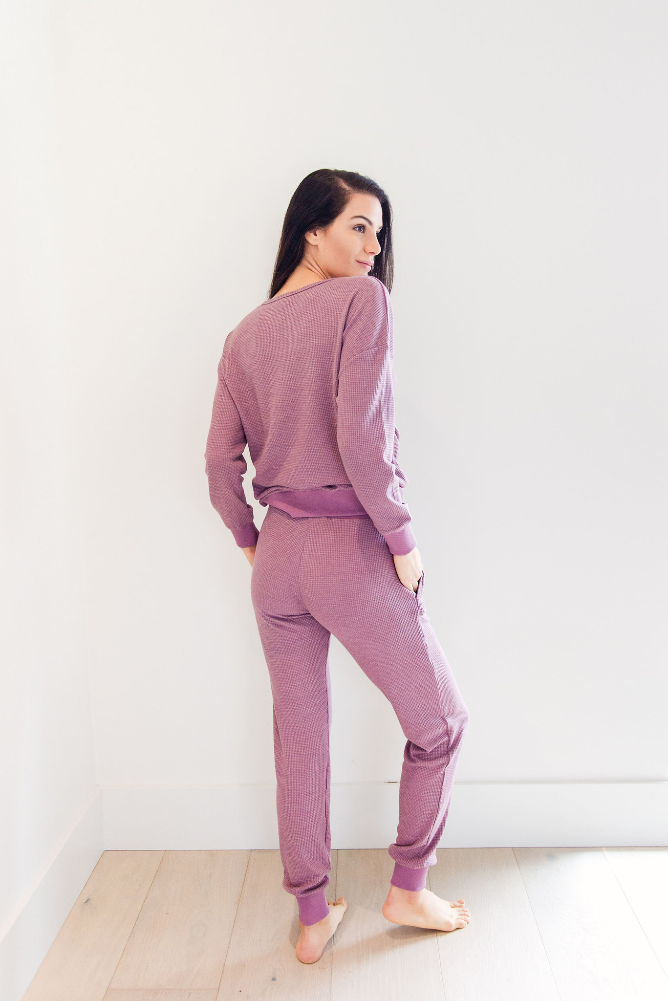 The Waye waffle set that sold out in three colors so fast, is now available in a brand new exclusive color!  Did somebody say waffle?  Listen.  Nobody doesn't like waffle fabric.  This two piece lounge set features a long sleeve crew neck top, with cuff sleeves, and a long pair of loose tapered pants.  Both comfortable and fashionable, you can wear this both at home and around town.  You know what we will be wearing this season.    Model is 5'9 and wearing a size small.