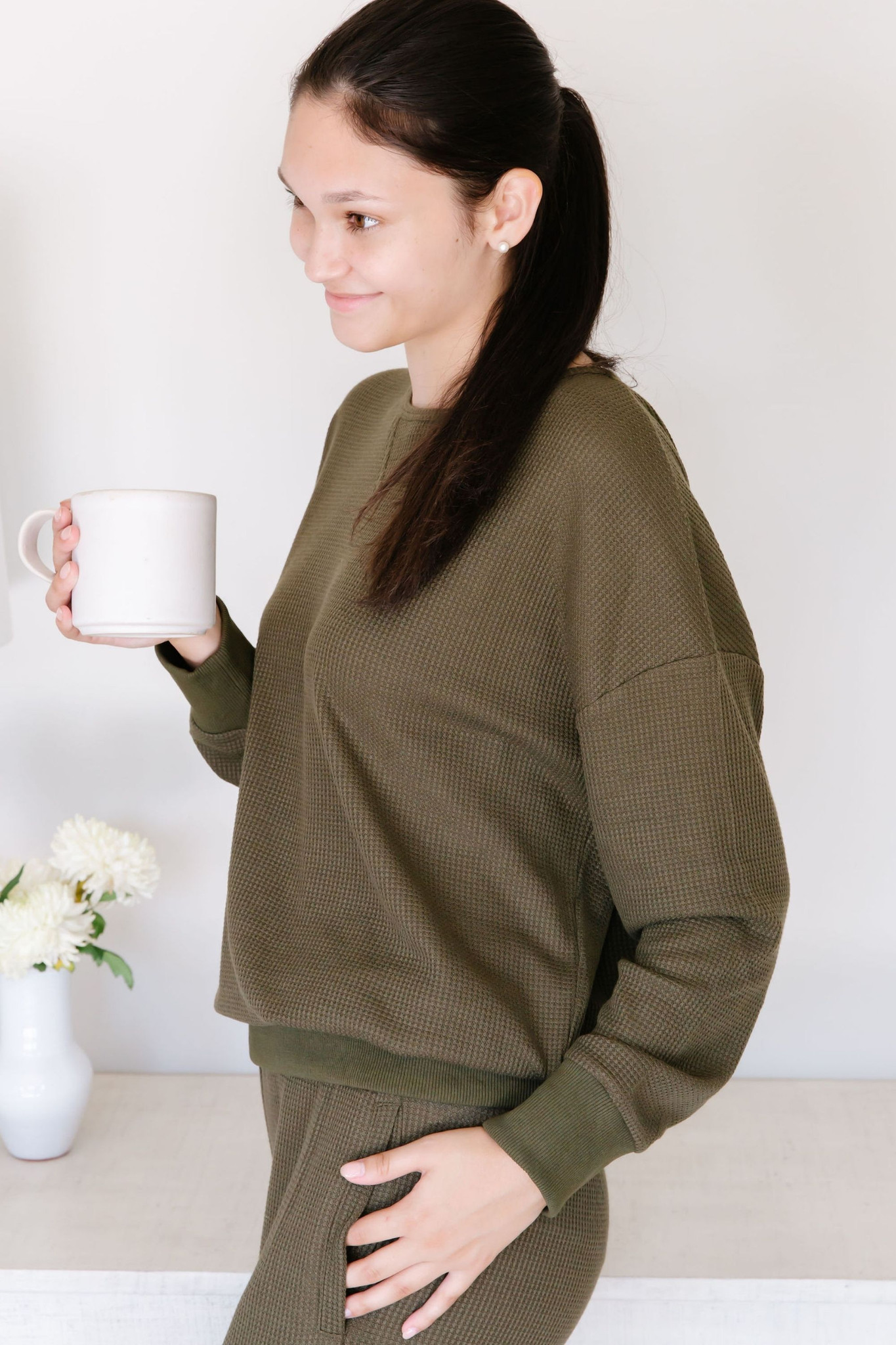 Did somebody say waffle? Listen. Nobody doesn't like waffle fabric. This two piece lounge set features a long sleeve crew neck top, with cuff sleeves, and a long pair of loose tapered pants. Both comfortable and fashionable, you can wear this both at home and around town. You know what we will be wearing this season.