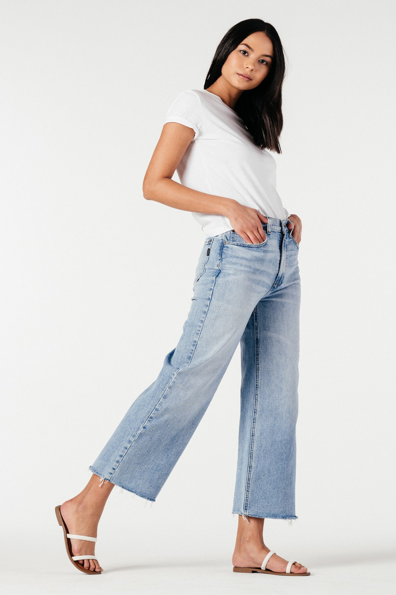 High and wide. For the MOD/AM girl who likes a bit of drama. This silhouette is full throughout the leg and showcases movement in a beautiful way. The light blue denim wash with some fraying at the hem is perfect for a beach day or brunch and a farmer's market. Paying homage to the 70s, this retro pant is made modern by its Ludwig Fabric, giving it a denim look that also stretches.