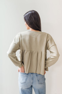 We're loving this new piece with its cute cropped details and ruffled peplum hem. Throw this on with your high waisted denim and casual runners for a dressed down look. 100% Cotton, Machine wash cold, Hang to dry