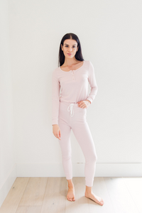 Our signature luxuriously soft sleepwear fabric cut with a feminine silhouette. The pants are fitted through the leg at ankle length with a soft, long sleeved henley shirt. We promise, you'll never want to sleep in anything else.