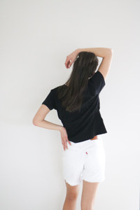 A basic tee with a feminine touch; the Laurel features a gathered waist with elasticated rouching, a clean hemline and short, cropped sleeves. Fits loose and flows through the torso, with fitted shoulders and arms.