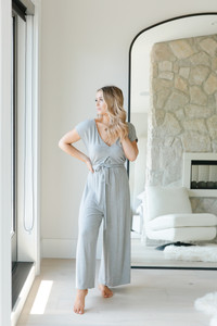 This loose jumpsuit can be worn tied around the waist, or flowy and open.  Effortless and comfortable, you can lounge around, or romp around town.  The most comfortable thing you will own this season!  - Available in Black and Grey  - Cold water wash and lay flat to dry