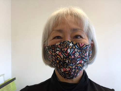 """100% Quilters Cotton home sewn as a solution to a shortage of masks in our country. My own county is in need of masks and I can't make them fast enough.   Elastic is not the ideal choice for tying around the ears. Doctors who are wearing 18 hours with elastic get rashes behind their ears. I've used t-shirt material strips as ties for around the ears and you can replace them as desired. To replace your ties,  Simply cut a strip of t Shirt Jersey material about 10-12 inches long x 1.25"""" wide cut from hem to neck.  Safety pin one end to old tie and add the new one and pull through. Discard the old tie.   Your purchases will help me Place a direct order time my manufacturer's (where I get my leggings) to order bulk the N95 the hospitals need."""