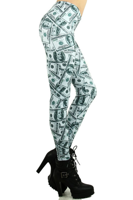 "Imported Gorgeous Money Print Leggings Features a Collage of Hundred Dollar Bills Green and White Color Combo Full Length with Banded Elastic Waist 92% Polyester 8% Spandex Model is wearing a One Size Measurements are 32B x 24 x 35 and height is 5' 8"" (172.7 cm) Hand Wash or Professional Wash"