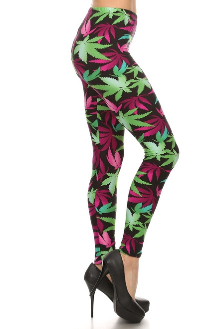 """Imported  Ideal for Sizes 0 - 10 (12 Depending on Body Type)  Sexy On Trend Fuchsia Colored Marijuana Leggings  Ultra Comfy Milk Silk Fabric  Sexy Body Hugging Fit  92% Polyester 8% Spandex  Model is wearing a One Size  Measurements are 32b x 24 x 34 height is 5' 8""""  Hand Wash, Professional Cleaning"""