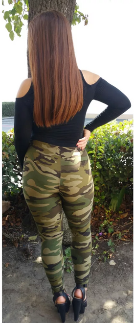 """Imported Comfortably Fits Sizes 0 - 10 (12 depending on body type) Authentic Camouflage Fashion Print Leggings Create the Most Amazing On Trend Outfits Amazing All Day Comfort with Milk Silk fabric Full Length and Elasticized Waist 92% Polyester 8% Spandex Model is wearing a One Size Measurements are 34C x 24 x 34 and height is 5'7"""" Hand Wash or Professional Wash"""