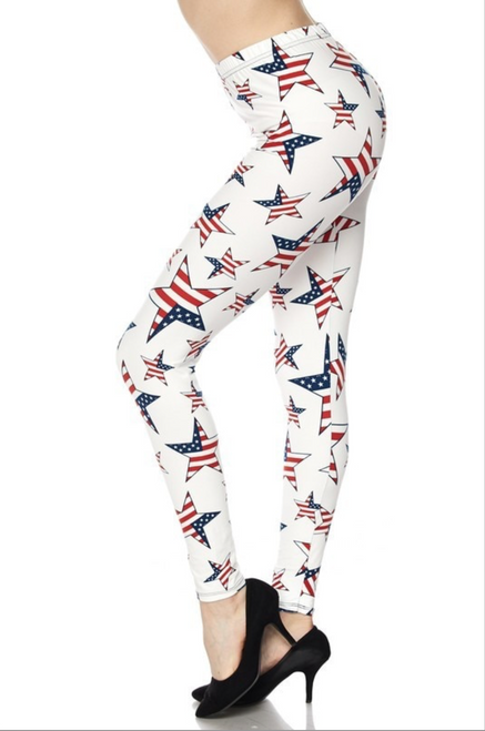 "Imported Ideal for Sizes 14 - 22 (24 Depending on Body Type) A Gorgeous and Rare Ivory Colored USA Flag Leggings Adorned with USA Flag Stars Ultra Comfy Milk Silk Fabric Sexy Body Hugging Fit 92% Polyester 8% Spandex Model is wearing a One Size Measurements are 32b x 24 x 34 height is 5' 8"" Hand Wash, Professional Cleaning"