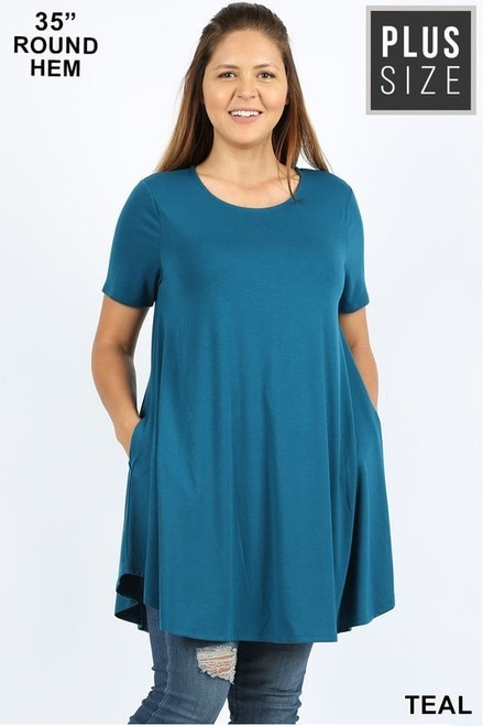 "Imported Longline Flared Top with Side Pockets Premium Plus Size Sleeveless Rayon Fabric Top  Round Neck Round Hem Top  Great Fit and a Wonderful Stand Alone Piece 55% POLYESTER 40% RAYON 5% SPANDEX Model is Wearing a 1XL Measurements are 38D x 36 x 46 and height is 5' 9""  Hand Wash, Professional Wash or Machine Wash Delicate"