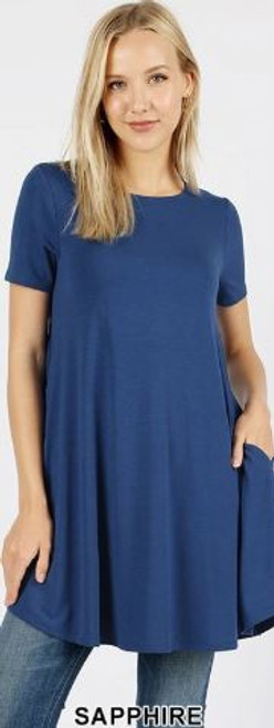 Imported Longline Flared Top with Side Pockets Premium Plus Size Sleeveless Rayon Fabric Top  Round Neck Round Hem Top  Great Fit and a Wonderful Stand Alone Piece 55% POLYESTER 40% RAYON 5% SPANDEX Model is Wearing a 2XL Hand Wash, Professional Wash or Machine Wash Delicate