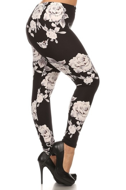 "Imported Comfortably Fits Sizes 14 - 22 (24 depending on body type) Black and White Floral Rose Design Ideal for Any Season Ultra Soft and Comfy Milk Silk Fabric 92% Polyester 8% Spandex Model is wearing Plus Measurements are 39D x 30 x 42 and height is 5'7"" (170.2 cm) Hand Wash or Professional Wash"