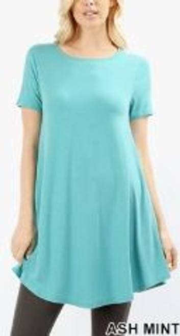 Imported Longline Flared Top with Side Pockets Premium Plus Size Sleeveless Rayon Fabric Top  Round Neck Round Hem Top  Great Fit and a Wonderful Stand Alone Piece 55% POLYESTER 40% RAYON 5% SPANDEX Model is Wearing a Large Hand Wash, Professional Wash or Machine Wash Delicate