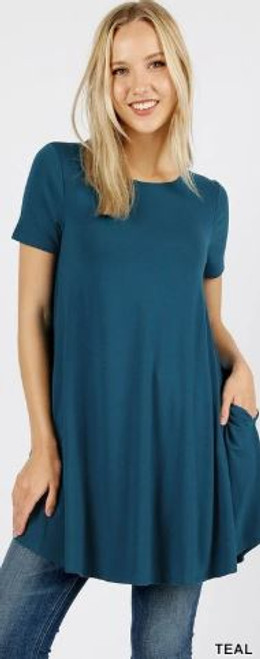 "Imported Longline Flared Top with Side Pockets Premium Plus Size Sleeveless Rayon Fabric Top  Round Neck Round Hem Top  Great Fit and a Wonderful Stand Alone Piece 55% POLYESTER 40% RAYON 5% SPANDEX Model is Wearing a Small Measurements are 33C x 24 x 25 and height is 5' 8""  Hand Wash, Professional Wash or Machine Wash Delicate"