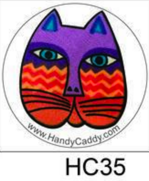 Laurel Burch Like Cat Face with Blue tipped ears and orange squiggly lines aka HP0035 These are the cutest Pop Handles EVER! aka Pop Sockets, Handy Pops come with a Car mount. 3M adhesive for both the Pop and the Car Mount makes it transferable. You can remove slowly and carefully. Then it can be replaced on another device. If it gets dirty, simply rinse it under water, let it dry and re-use.