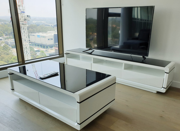 Gloss white coffee table with black tempered glass top