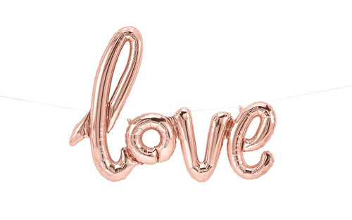 "42"" script rose gold love balloon. Listing includes: self-sealing love script mylar balloon (flat size: 42"" t x 25"" w / inflated size: 30"" x 23"") and string for easing hanging. Balloons do not float with helium air only, balloons are reusable! Use these over and over again for all your party needs. Located at Wild Minds Studio in Rugby, ND."