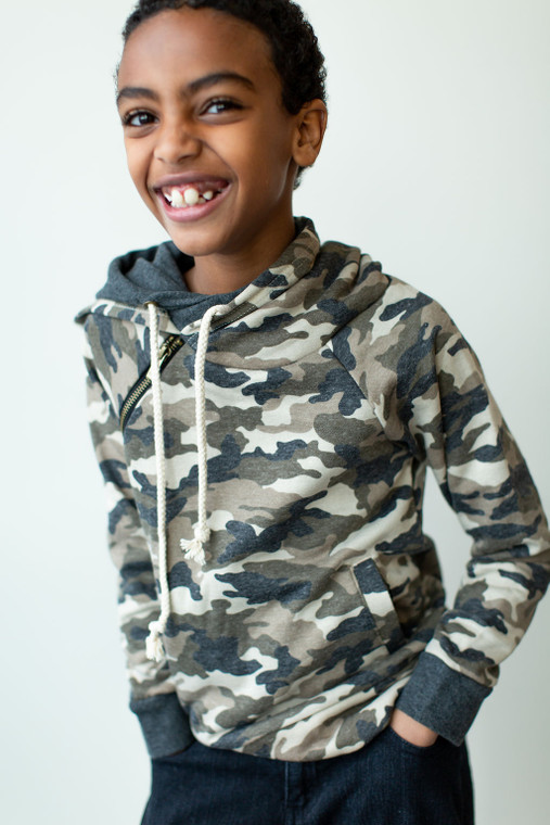 The Youth Ampersand Ave Double Hooded Sweatshirt will keep your little one cozy and warm in the cutest way. This camo cotton-blend hoodie features convenient pockets and thumbholes to warm up hands. The double hood is functional and stylish, adding a layer of colorful contrast to this fashionable sweatshirt. There's even a bonus zipper or button detail on the shoulder for a little extra, fun design.