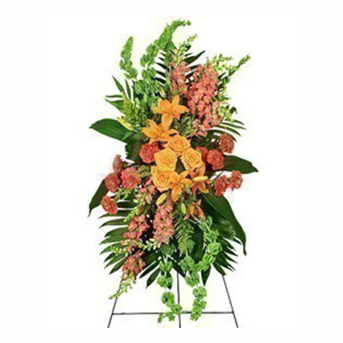 "54"" easel 1 large wet floral foam cage foliage: aspidistra leaves, leather leaf, jade 10 hot pink carnations 4 orange roses 6 bells of Ireland 8 peach snapdragons ('Talisman') 3 stems orange Asiatic lilies 3 stems solidago"