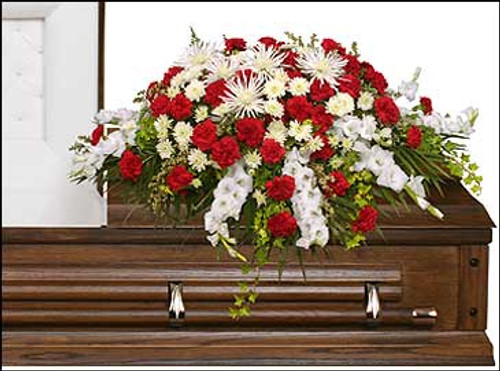 casket saddle with wet floral foam foliage: teepee, ivy, leather leaf 10 stems white gladiolus 40 red carnations 5 white Fuji mums 5 stems white cushion poms 5 stems white waxflowers