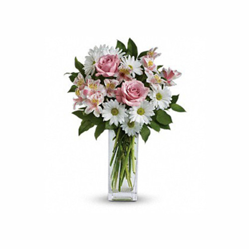 "Soft and delicate, this pale pink and white bouquet speaks to the purity and simplicity of your adoration. This angelic bouquet includes soft pink roses, light pink alstroemeria, white daisies and glossy green lemon leaf. Delivered in a Bunch vase. Approximately 14"" W x 19"" H"