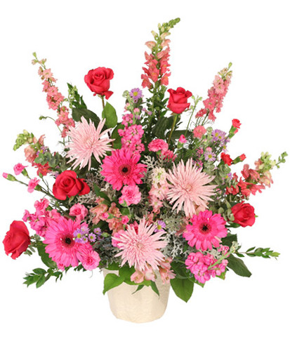 6-J maché container wet floral foam foliage: myrtle, salal, eucalyptus ('Baby Blue'), dusty miller  pink snapdragons stems hot pink larkspur  pink spider mums  hot pink gerberas  red roses  stems lavender aster ('Monte Casino') stems hot pink mini carnations