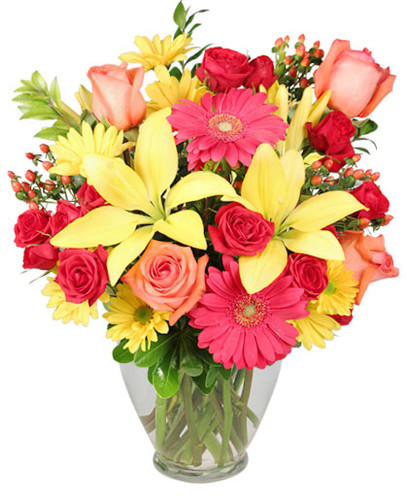 ginger vase foliage: pittosporum, myrtle 2 hot pink gerberas 3 stems red miniature spray roses 4 coral roses 2 stems yellow daisy poms 4 stems red hypericum 2 stems yellow lilies