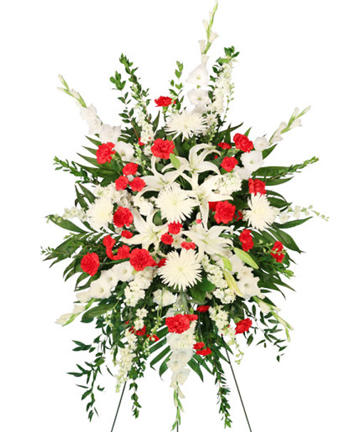 "A Kiss Goodbye Standing Spray  Shown at $235.00	54"" Easel large wet floral foam cage Foliage: Emerald, Myrtle, Ruscus, Salal white Gladiolus stems white Larkspur white Stock stems white Lilies  white Spider Mums red Carnations  stems red Mini Carnations"
