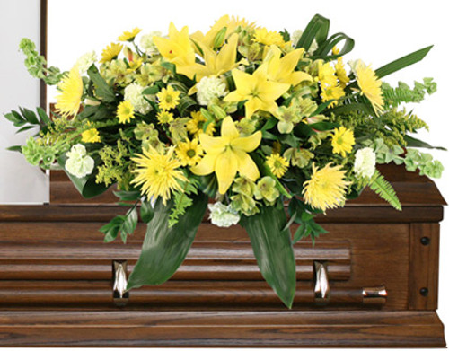 asket saddle with wet floral foam Foliage: Aspidistra, Sword Fern, Salal 3 stems yellow Asiatic Lilies 9 pale green Carnations 5 stems yellow daisy Poms 5 stems green Alstroemeria 5 yellow Spider Mums 4 Bells of Ireland