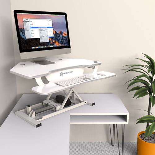 The PowerPro® Deluxe Corner Sit- Stand Desk by VersaDesk